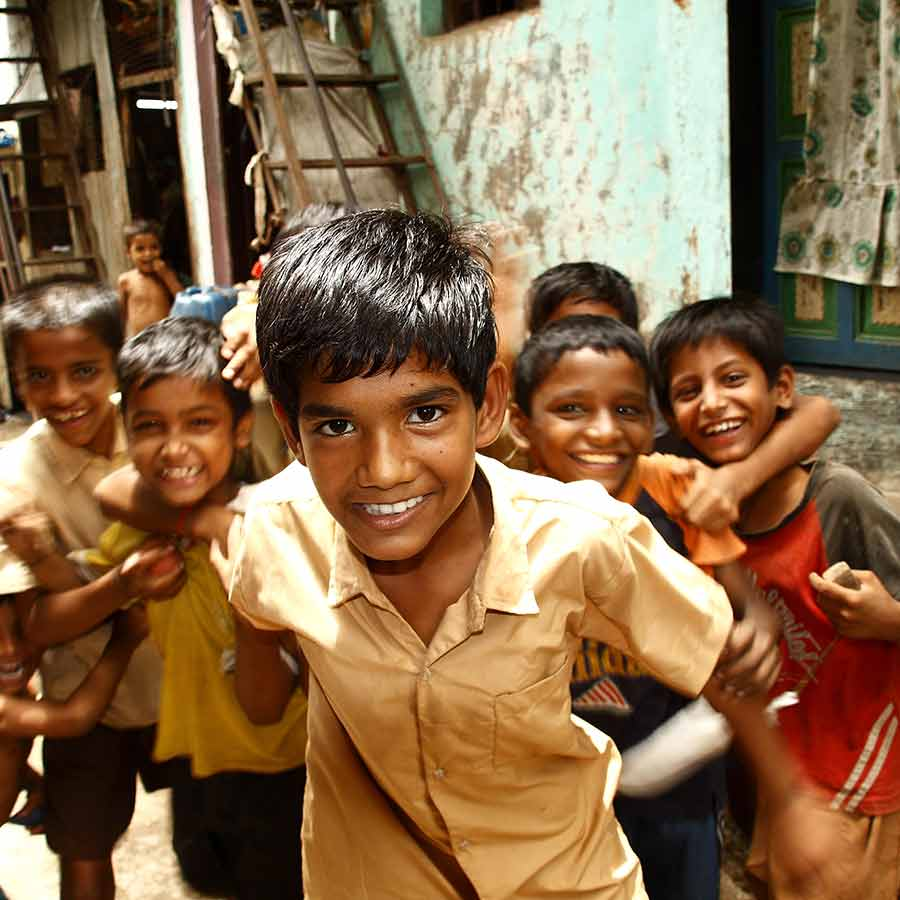 Crowd of smiling boys in Mumbai